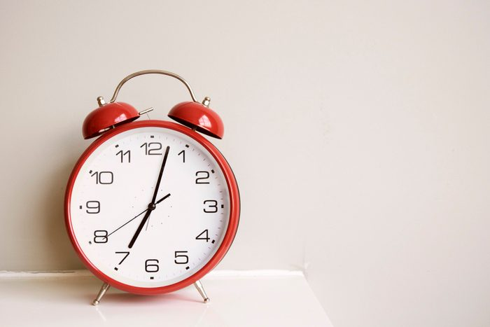 doctors eat for breakfast   alarm clock on bedside table