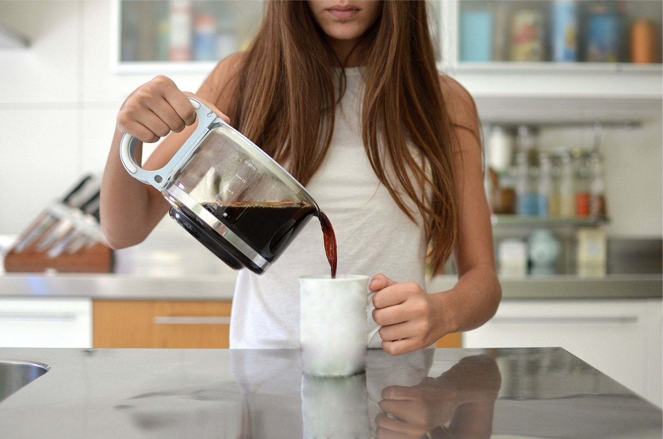 cause dehydration | woman pouring coffee into mug