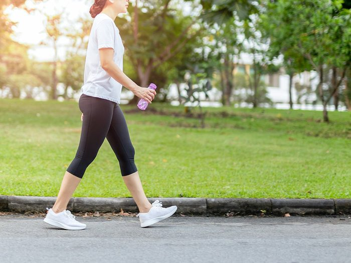 How to make walking less boring - woman walking in park