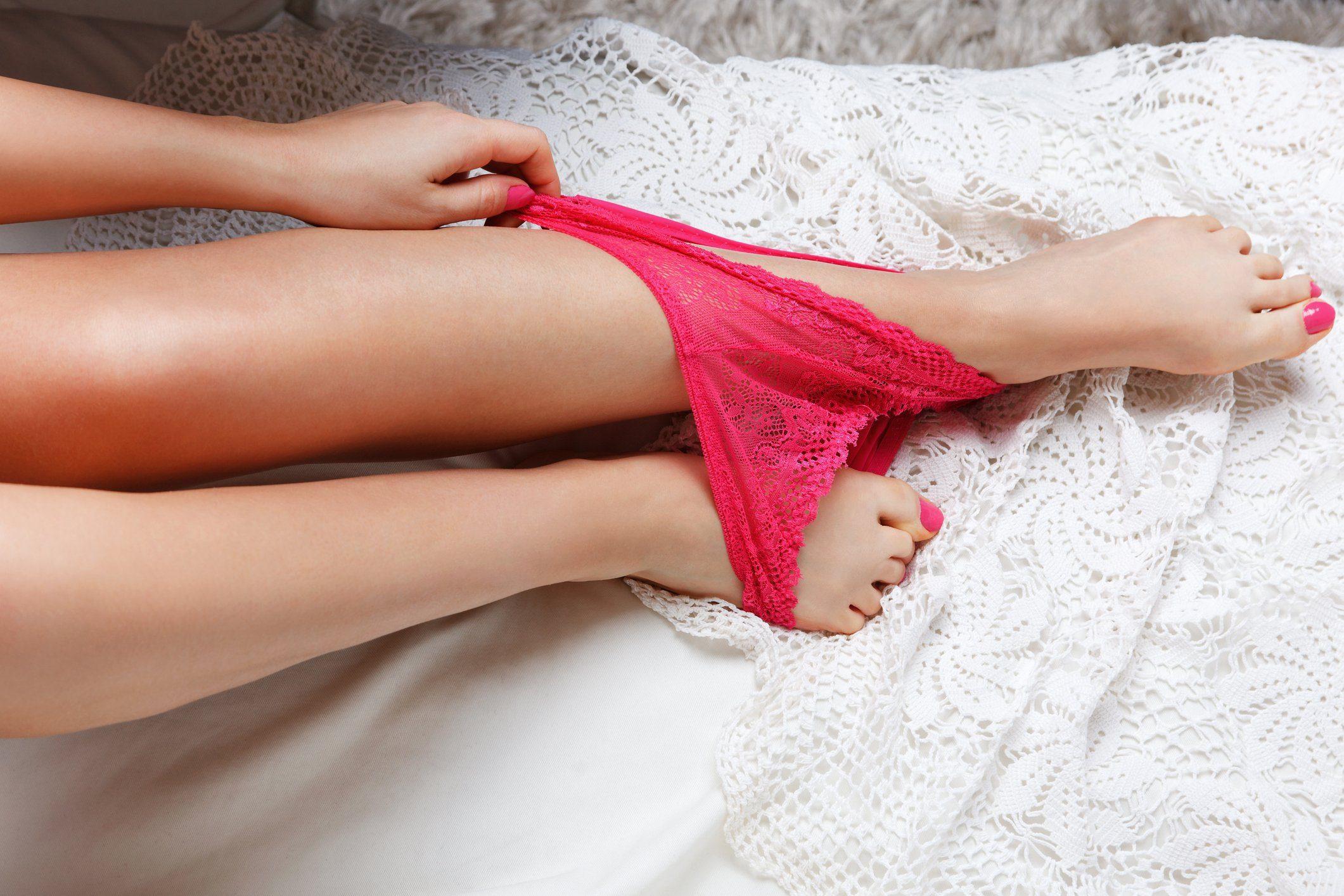 overhead shot of woman putting on underwear