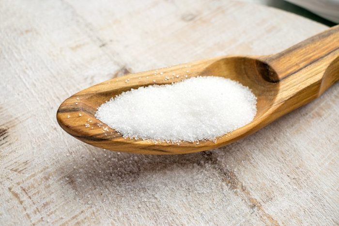 Artificial Sweeteners and Sugar Substitutes in wooden spoon. Natural and synthetic sugarfree food additive: sorbitol, fructose, honey, Sucralose, Aspartame | foods to avoid before workout