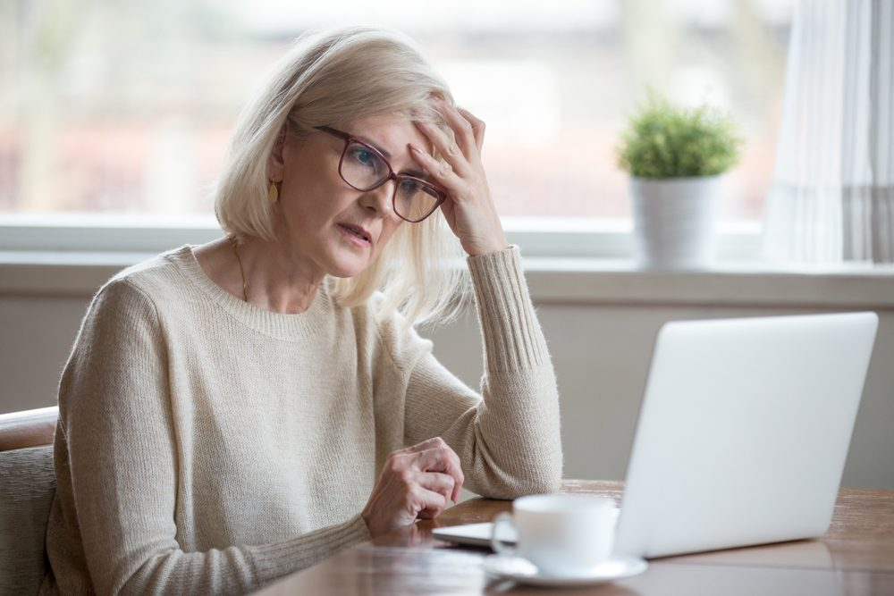 early-onset Alzheimer's | Thoughtful confused mature business woman concerned thinking about online problem looking at laptop, frustrated worried senior middle aged female reading bad email news, suffering from memory loss