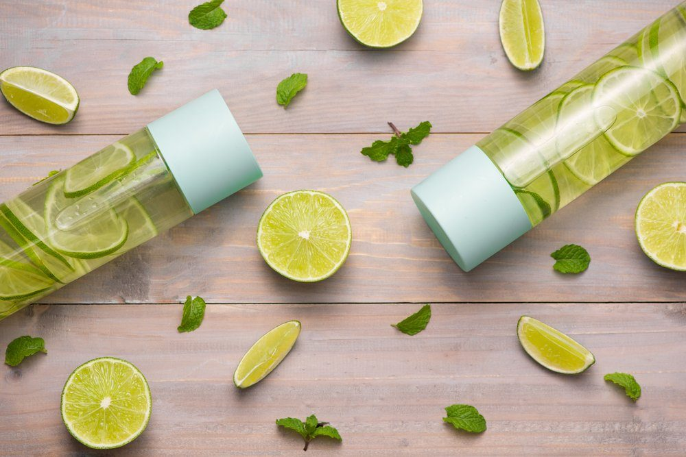 Water with Lime and Mint in Sports Bottle, with slices of lime. | foods to avoid before workout