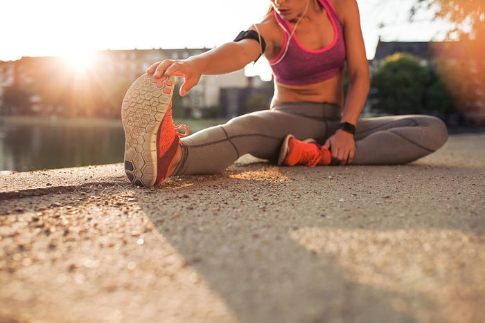 woman stretching in workout gear