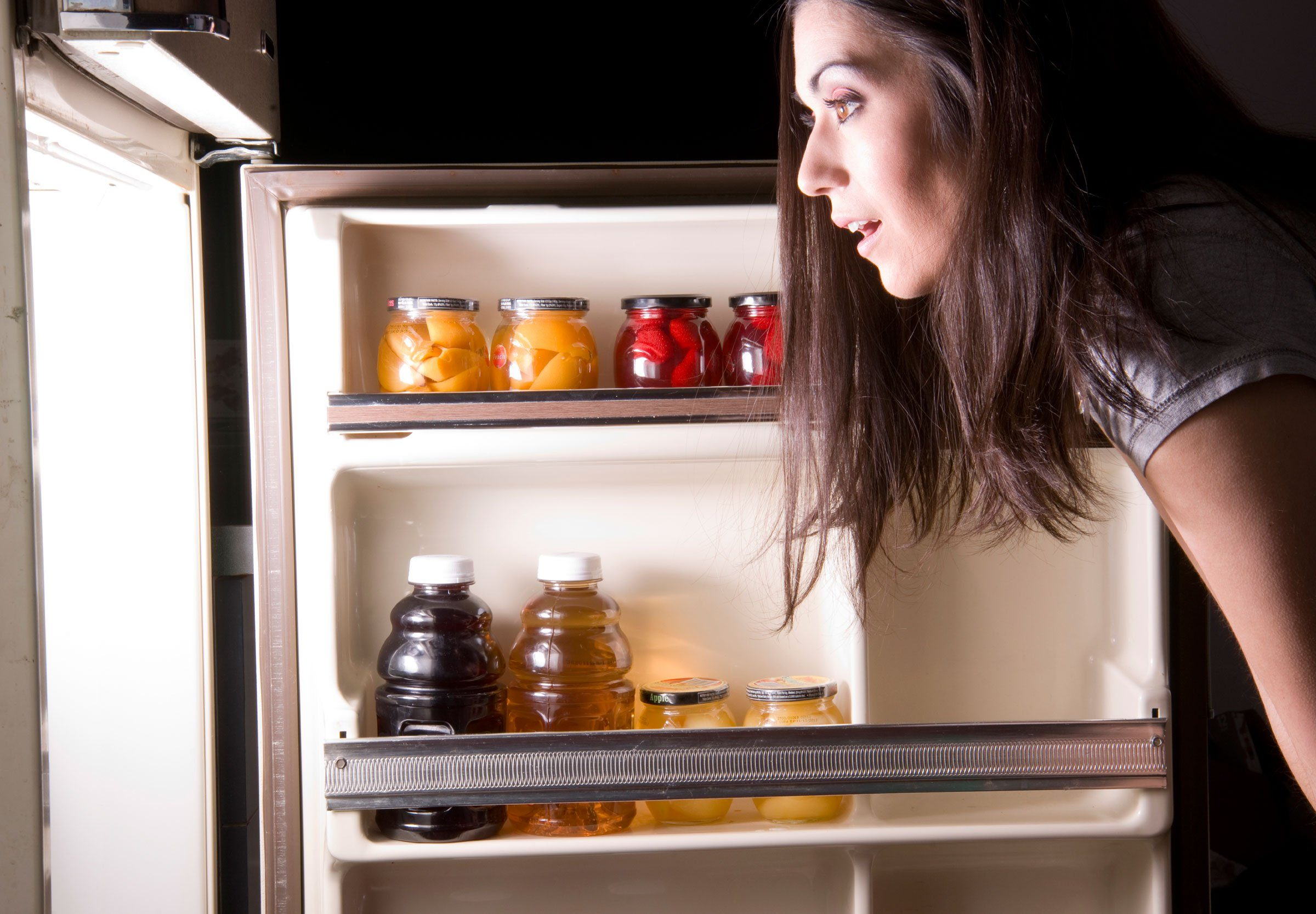maintain a healthy weight | woman looking into a refrigerator