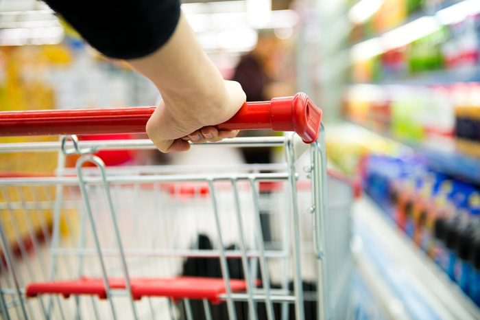 generic food brands | Closeup of woman with shopping cart