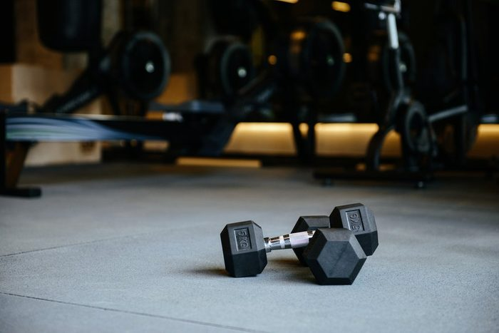 fitness after 50 | dumbbells which lying on the floor in gym