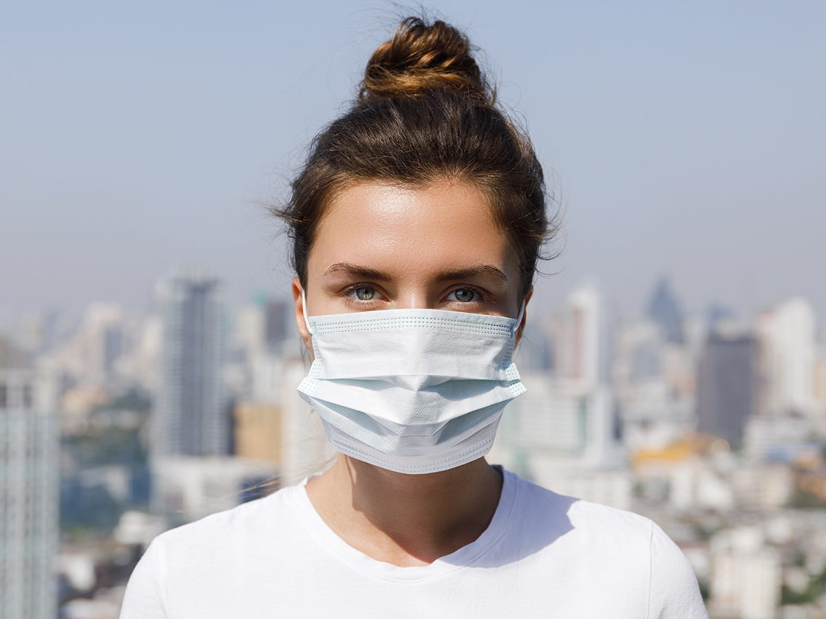 maskne | woman wearing pandemic face mask