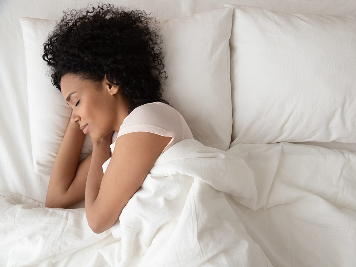woman sleeping | sleep problems trying to tell you