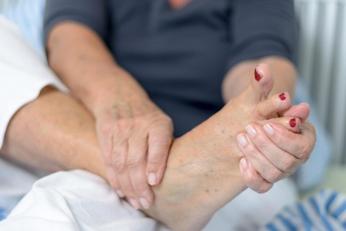 type 2 diabetes complications | hands holding foot
