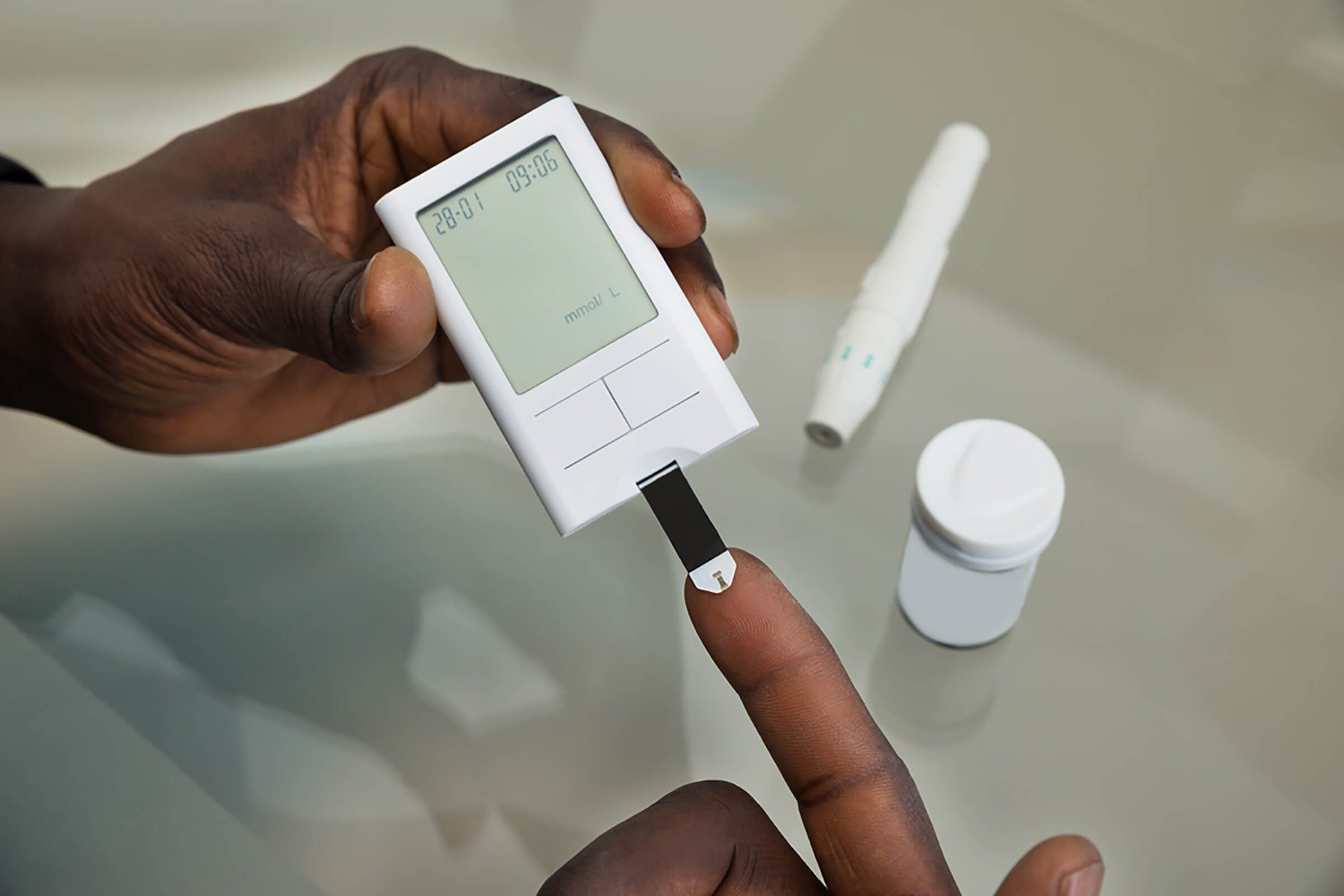 type 2 diabetes complications | checking blood glucose with finger prick
