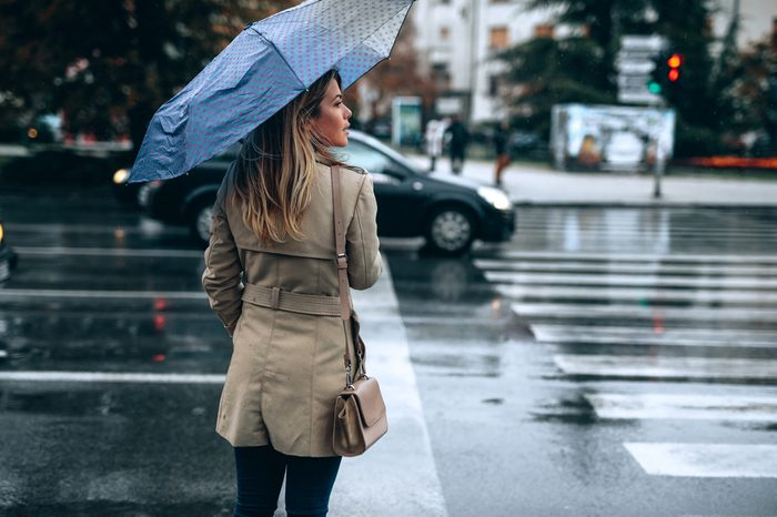 Beautiful woman with umbrella on a rainy day.