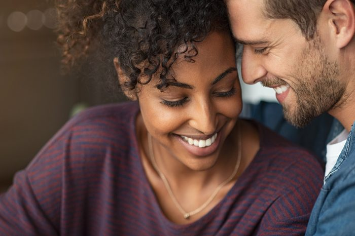 successful relationships   young romantic couple smiling together