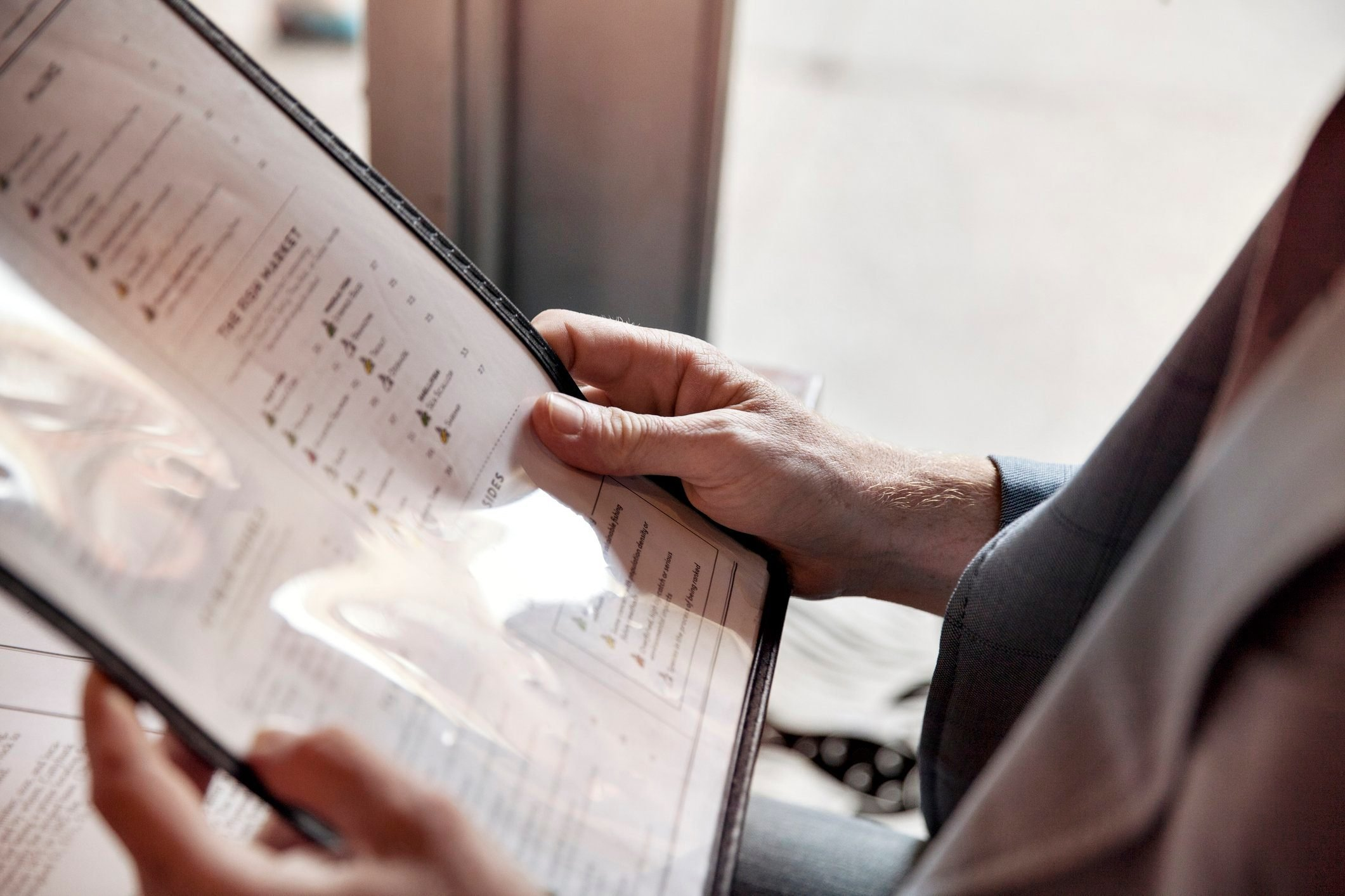 diabetic breakfast | Cropped image of man holding menu while sitting in restaurant