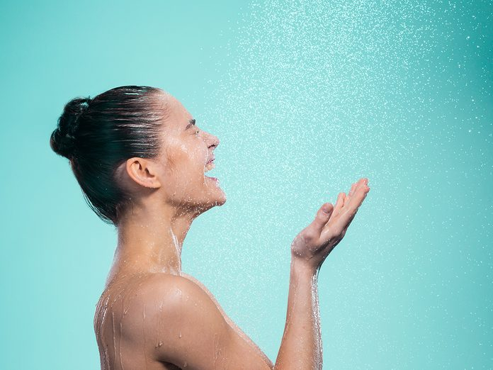 benefits of cold shower | woman in shower