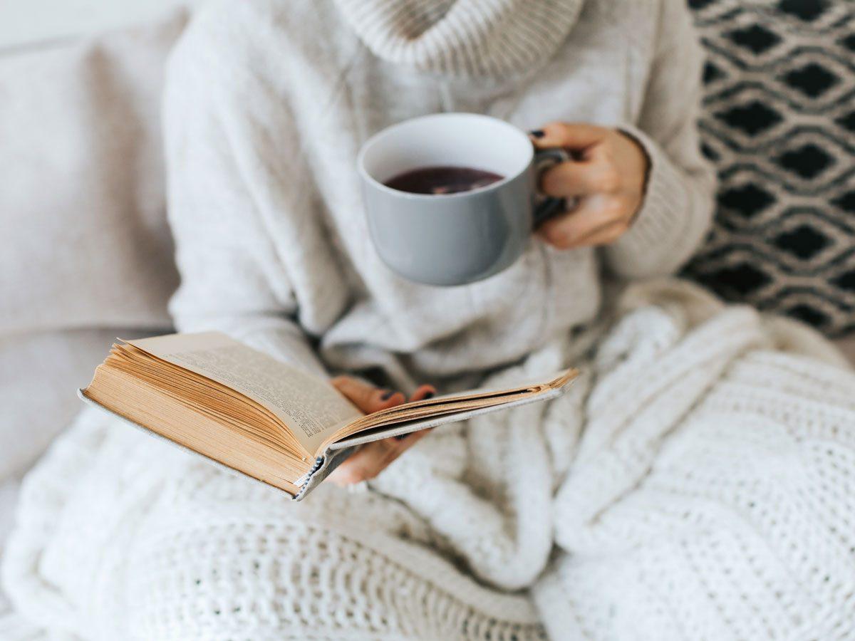 fall loungewear | woman reading and drinking coffee
