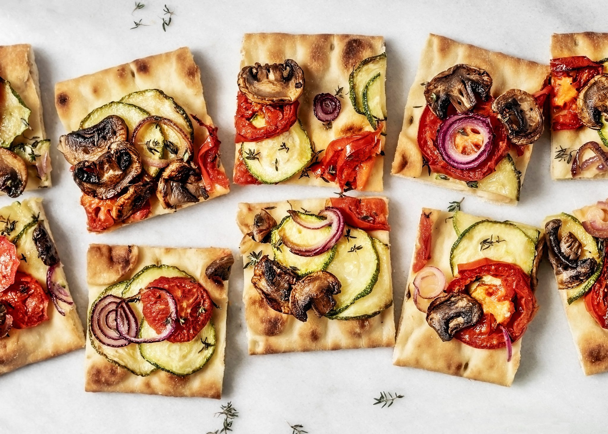 Vegetarian flatbread pizza on white background