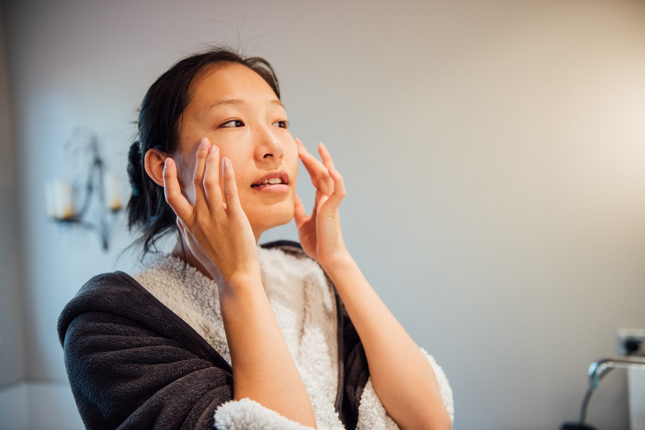 rosacea   woman washing her face   home remedies