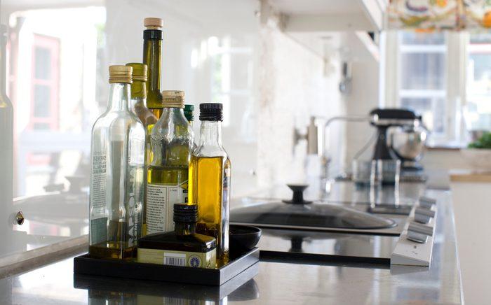 healthiest cooking oils   oil Bottles on kitchen worktop, close-up