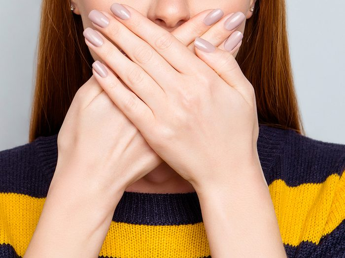 Halitosis | woman covering her mouth