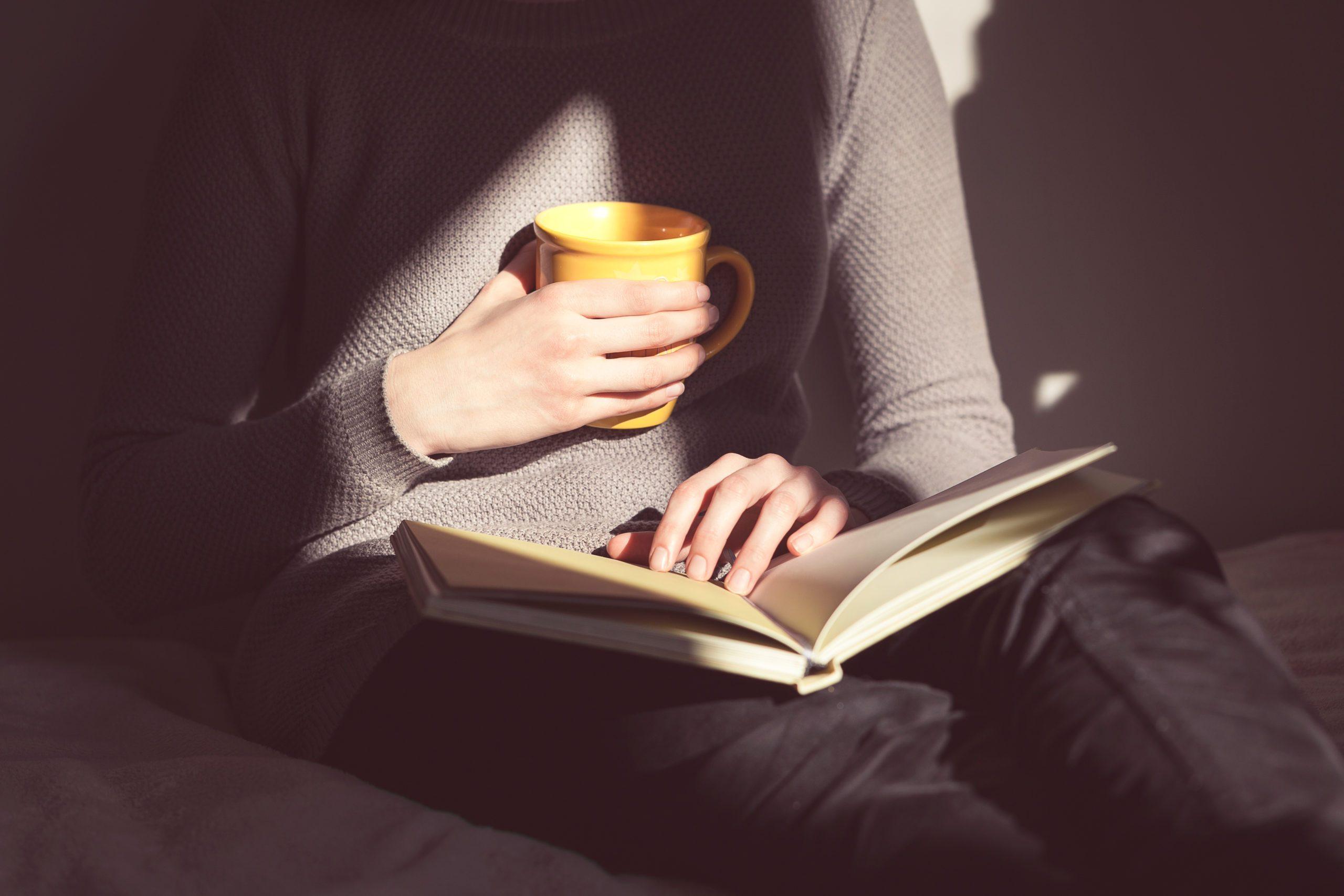 impact | woman holding mug and book | al etmanski