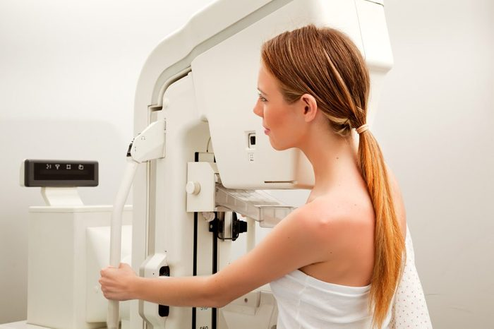 A young woman taking a mammogram x-ray test