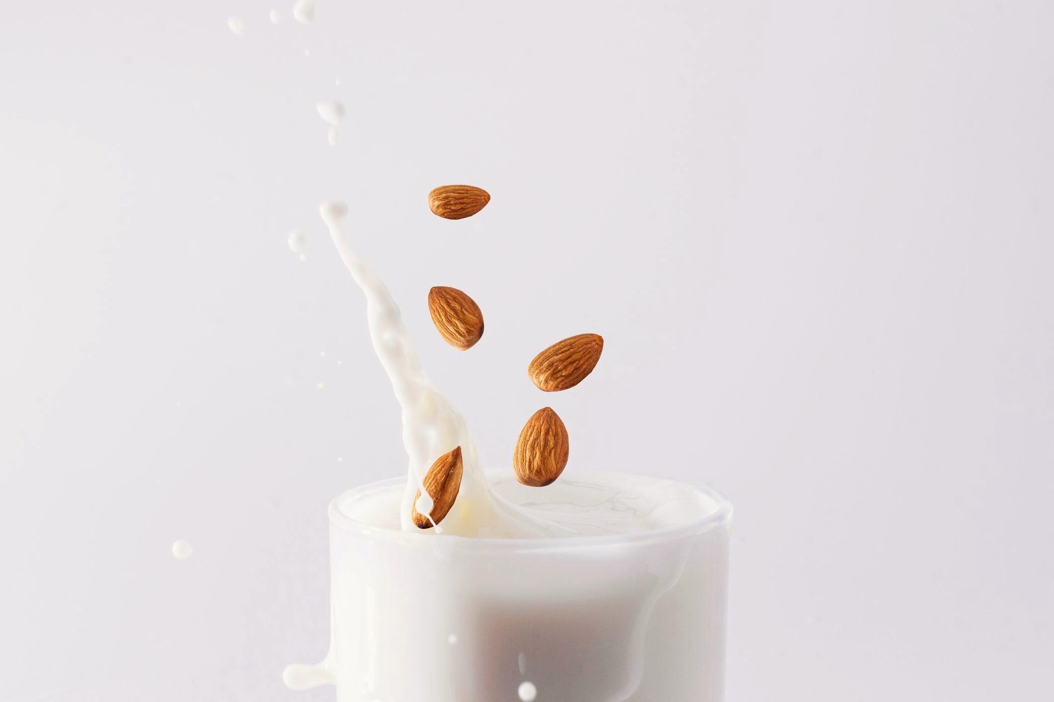is almond milk good for you? | almonds splashing in milk