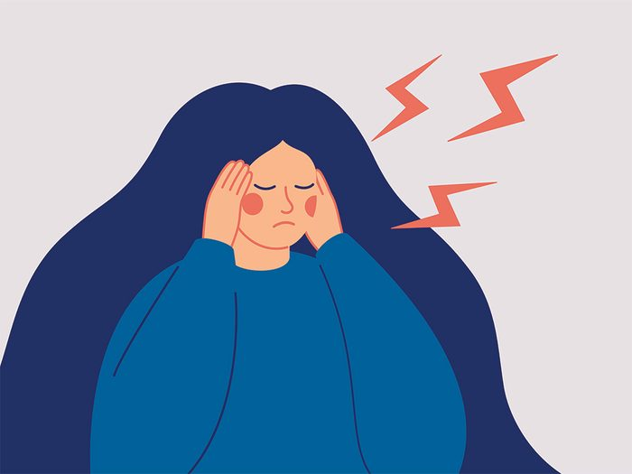 headache-vs-migraine | illustration of a woman clutching her head
