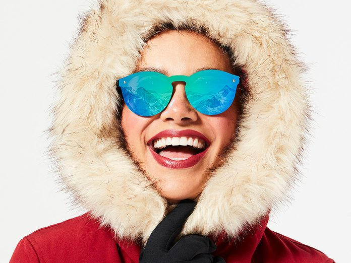 outdoor workout warm up and cool down   woman wearing sunglasses with a snowy reflection in them