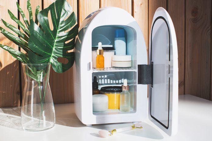 beauty fridge | image of a beauty fridge against a wooden wall | do i need a beauty fridge