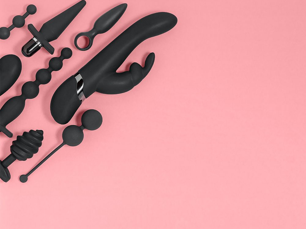 affordable sex toys | black sex toys on a pink background