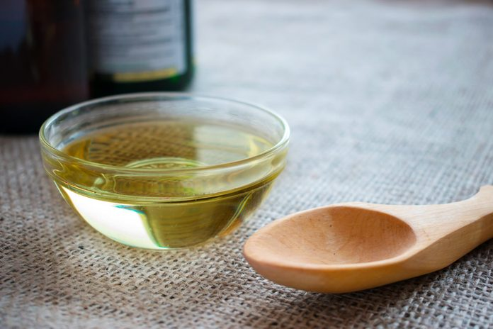 MCT oil benefits | Liquid Coconut Mct Oil In Round Glass Bowl With Wooden Spoon And Bottles Health Benefits Of Mct Oil Triglycerides A Form Of Saturated Fatty Acid