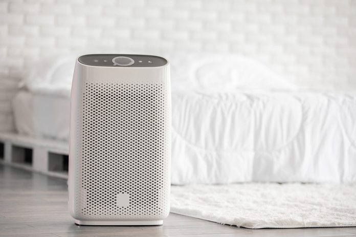 Air Purifier In Cozy White Bed Room For Filter And Cleaning Removing Dust Pm2 5 Hepa In Homefor Fresh Air And Healthy Lifeair Pollution Concept