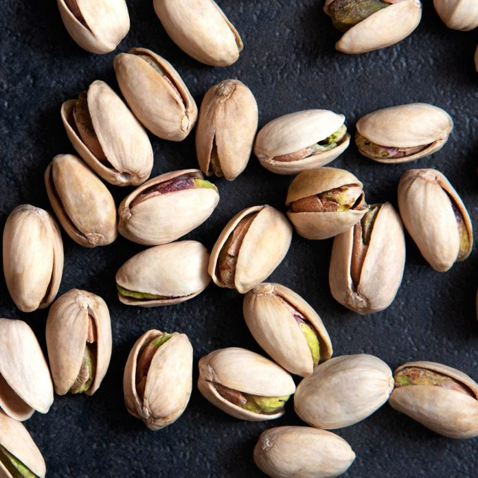 are pistachios good for you? | Roasted pistachios nuts on dark background. Healthy snack
