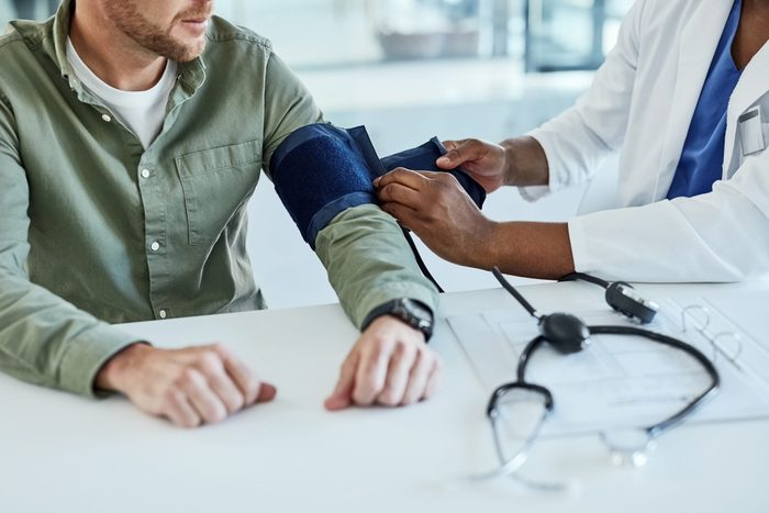 high blood pressure | man getting his blood pressure checked by the doctor