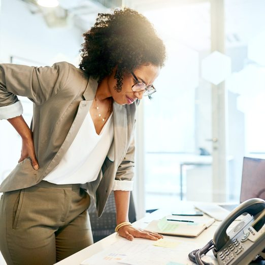 lower back pain in women | Prolonged Sitting Puts A Lot Of Strain On The Lower Back