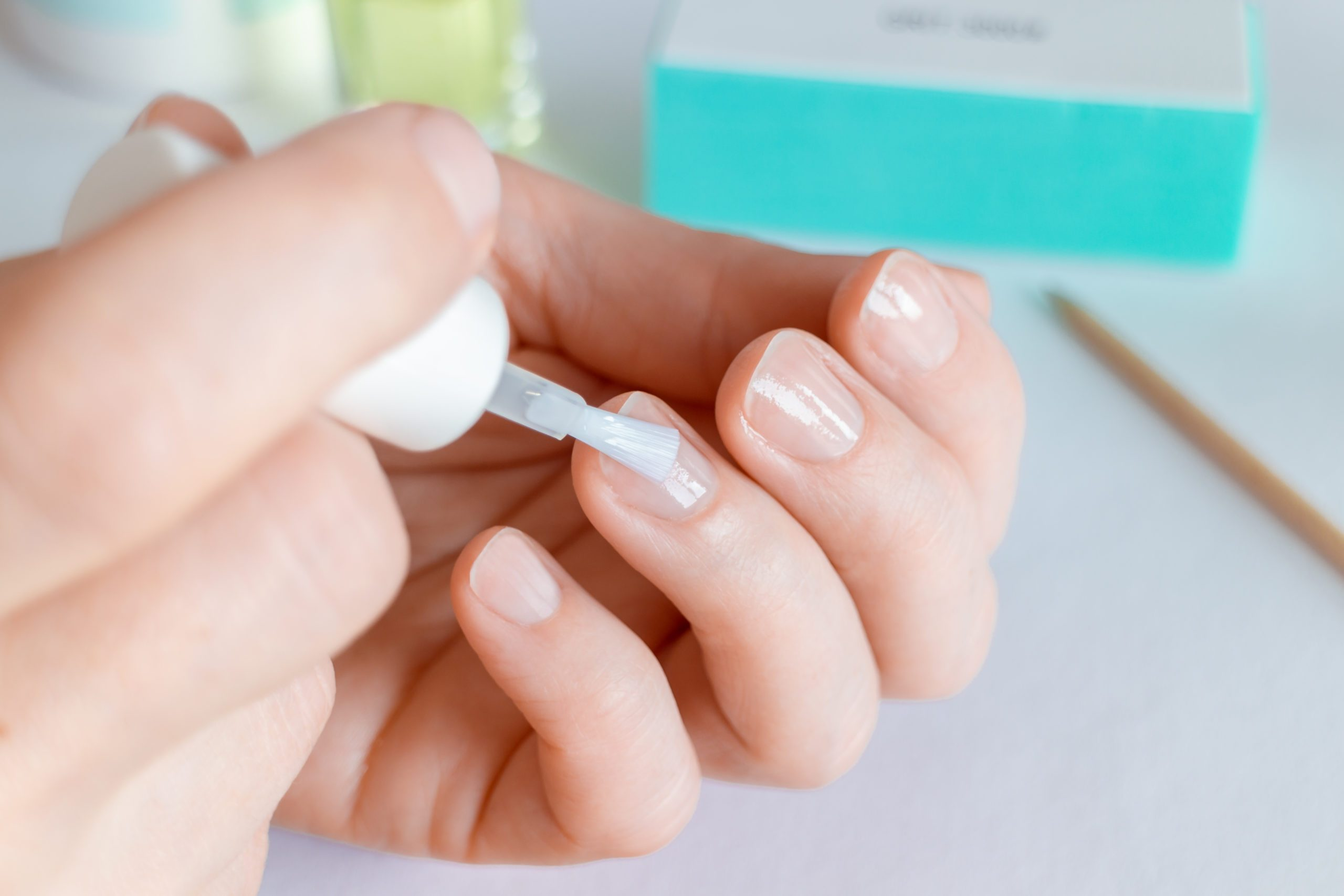 Woman,doing,at Home,manicure,,applying,nail,conditioner,or,base,coat.