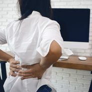 theragun elite canada | Business,woman,suffering,from,back,pain,in,office,home