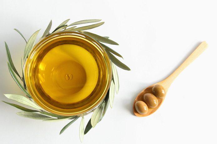 olive leaf tea | Olive Oil Bowl With Olive Branch And Green Olives Photo
