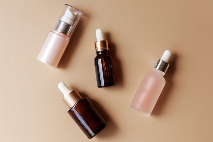 Set Of Amber Glass Cosmetic Bottles On Brown Background Pump Bottle Dropper Bottle Dispenser Cosmetic Container Flat Lay Top View