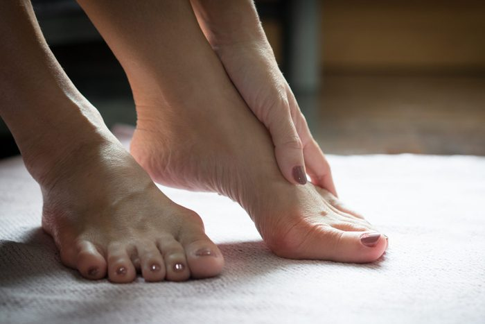 what is a bunion   Bare Feet Of Beautiful Working Woman Resting Her Toes At Home To Release Pain Of Her Bunions Hallux Valgus Toes