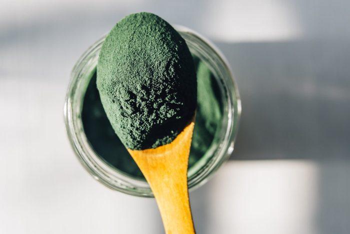 spirulina benefits   Spirulina Powder In A Wooden Spoon