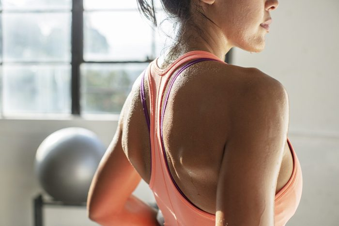 how to get the sweat smell out of clothes   Midsection Of Female Athlete Standing In Gym