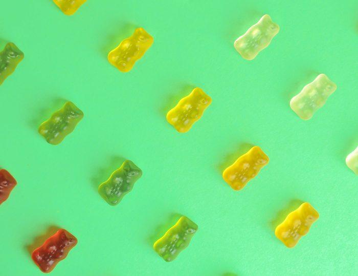biotin supplements   Gummy,bear.,kids,vitamins,on,colorful,background.