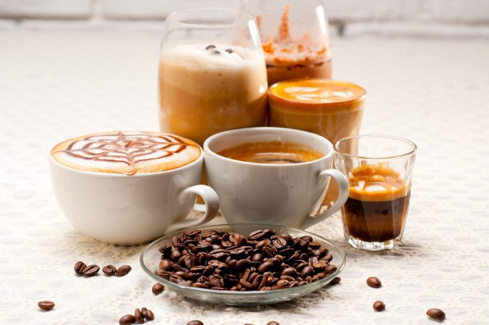 types of coffee | Close Up Of Coffees With Roasted Coffee Beans Served On Table