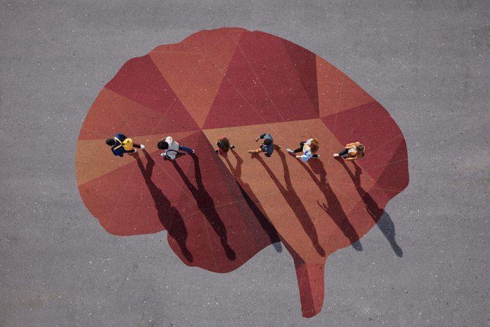People Walking In Line Across Painted Brain On Asphalt 2