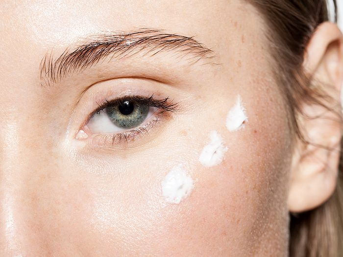 Close Up,of,a,woman's,face,with,moisturizer,on,the,cheeks