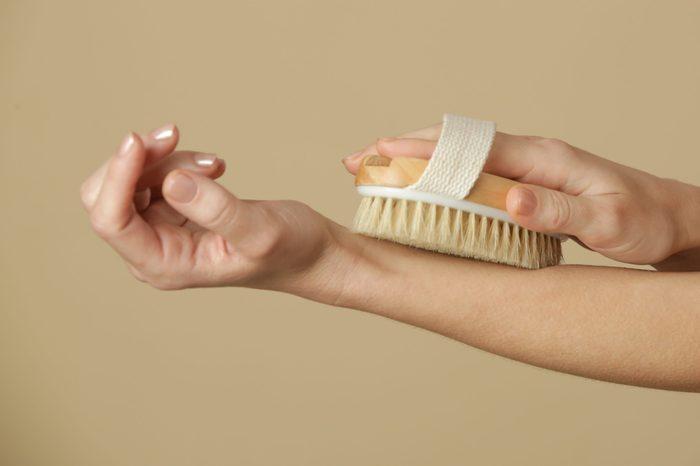 dry brushing | Dry,body,brush,,woman,dry,brushing,body,to,reduce,cellulite,