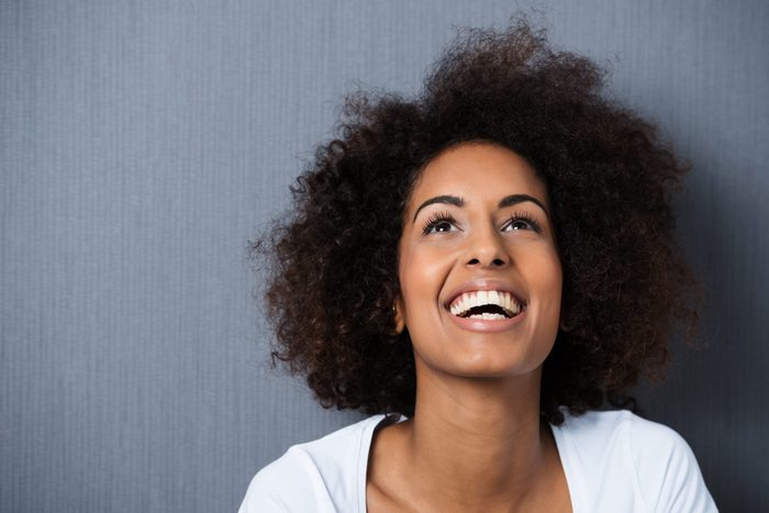 ambivert | Laughing,african,american,woman,with,an,afro,hairstyle,and,good