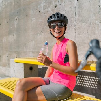 padded bike shorts   woman in bike shorts and helmet sitting on a bench